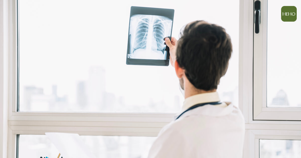 rear-view-male-doctor-examining-chest-x-ray